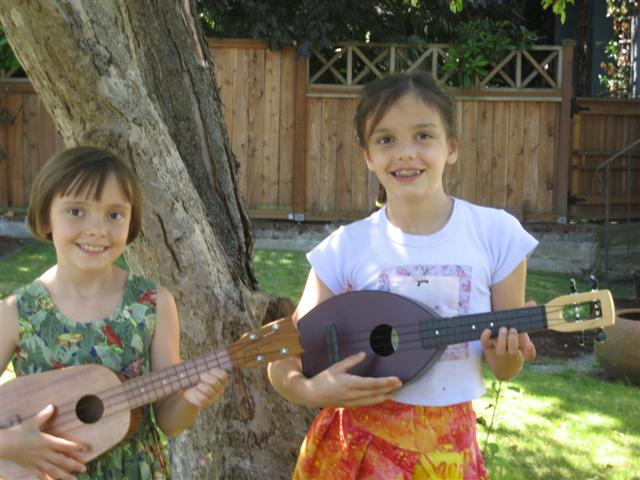 Christine and Kathryn learn to play 'ukulele